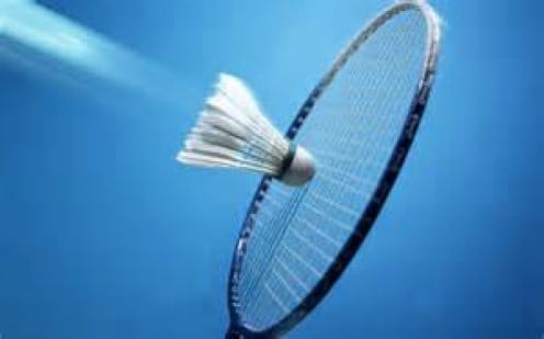 Badminton requires a racket which is used to hit a shuttlecock or birdie. A shuttlecock is a plastic, feathered shaped item that is hit with a racquet.