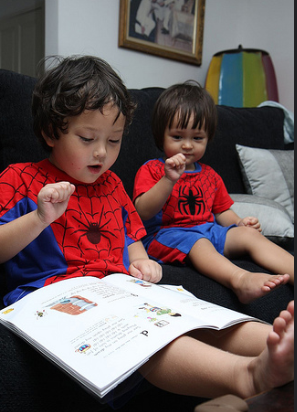 Surround your children with books and read aloud to them.