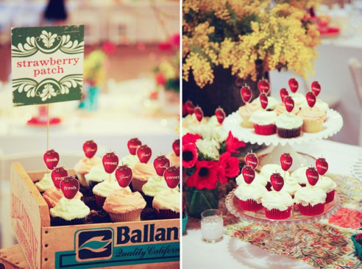 Cupcakes with strawberry label used as place cards