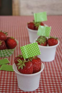 Strawberries in a cup used as place cards