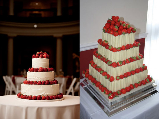 A traditional multi-layered wedding cake with each layer topped with strawberries.