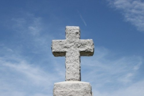 Stone cross on tombstone