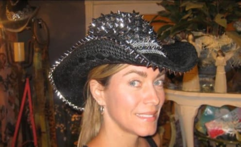 T.W. A.K.A Suzanne sporting a wild cowgirl hat covered with spikes.