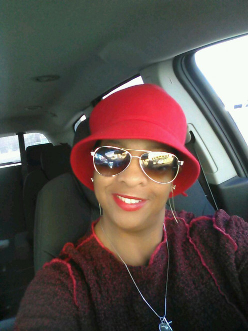 Ms. Vivan can also rock a hat in bold red as well!
