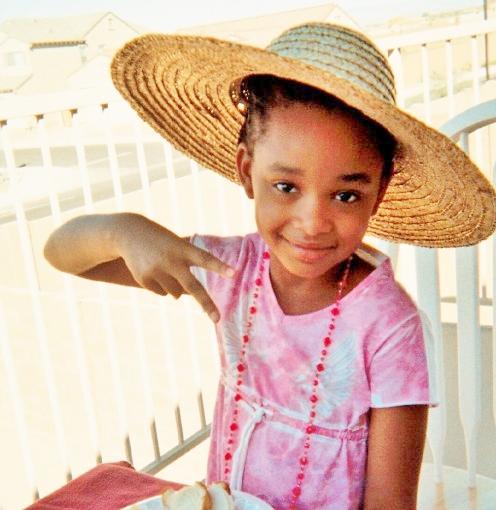 Little girl in hat rocking her wide brim straw hat!