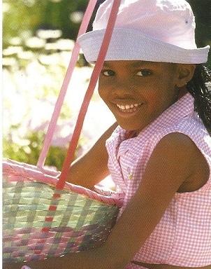 Little girl wearing her Easter hat.