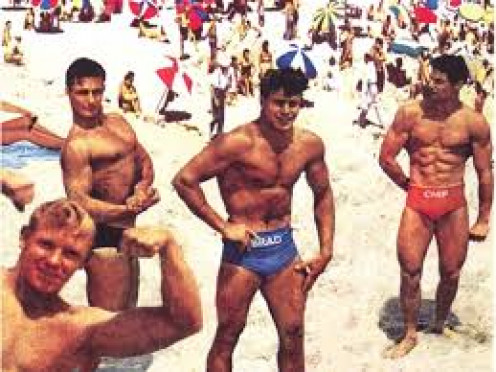 """He Men"" loved to show off their muscles on the beach."