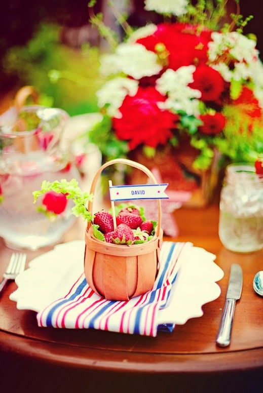 Strawberries in a basket that will also serve as guest place cards.