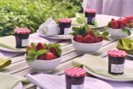 Strawberry jam favors can also serve as place cards