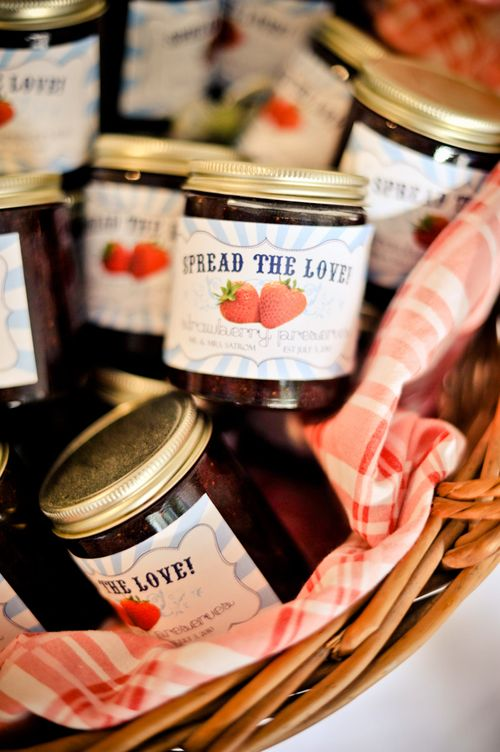 Homemade strawberry jams with customized jar labels.