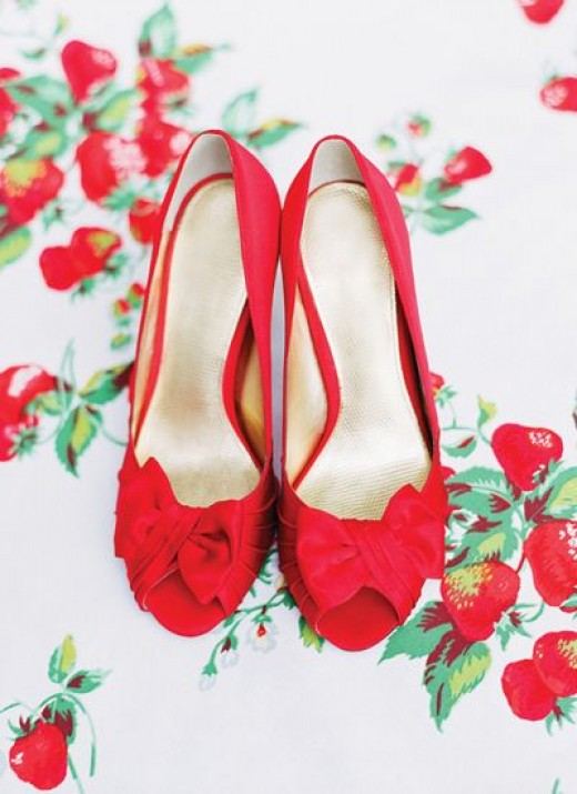 A gorgeous pair of peep-toes in red strawberry.