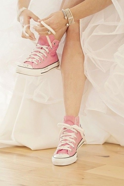 For the non-conventional bride: strawberry pink sneakers.