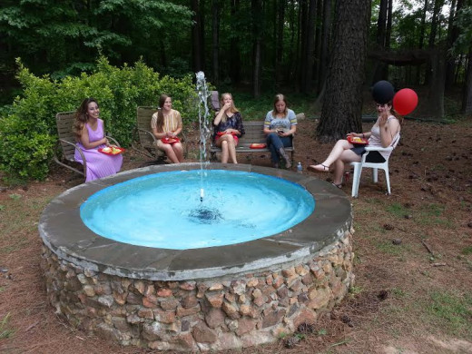 My daughter and her friends relax in May of 2014 by the deceptively virginal-looking fountain. Getting it back into shape had been a chore for me.