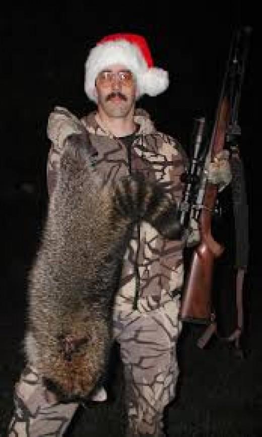 Coon hunter bags a big boar raccoon.