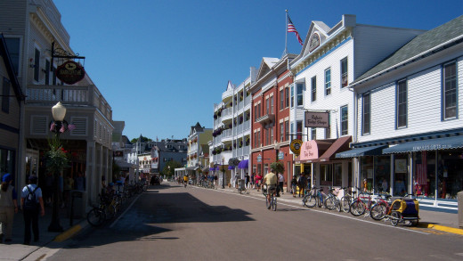 The welcoming beauty of the downtown area of Mackinac Island down the M-185 highway.  Note the absence of any automobile or motorcycle.