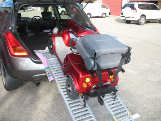 Loading mobility scooter into car via ramps