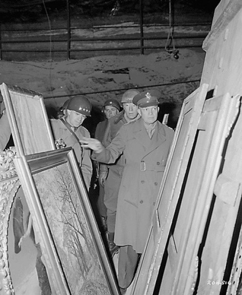 General Dwight D. Eisenhower, Supreme Allied Commander, accompanied by General Omar Bradley and Lt. Gen. George Patton, Jr., inspects stolen art treasures