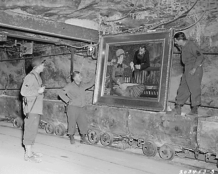 "U.S. Soldiers examine Edouard Manet's ""In the Conservatory,"" April 25, 1945"