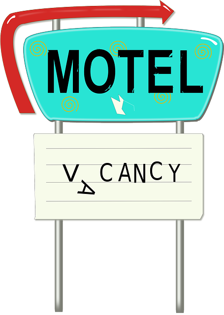 Motel clip art with the sign vacancy