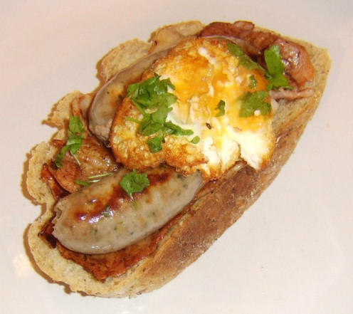 Bacon, egg and sausage sandwiches can be prepared in many different ways and this open sandwich featuring a twice cooked egg is just one of the many ideas you will find on this page
