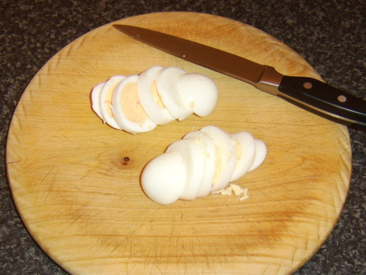 Hard boiled eggs are sliced