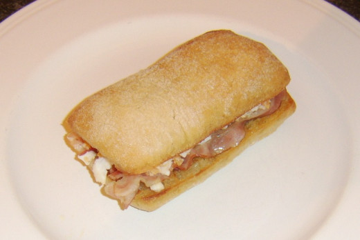 Ciabatta roll is closed over for cutting