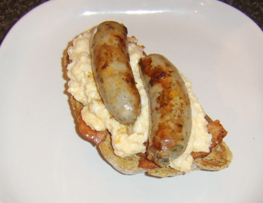 Sausages are laid on scrambled egg