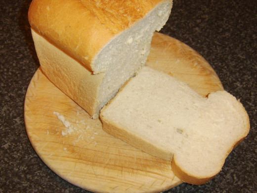 Thick slices are cut from a split tin loaf