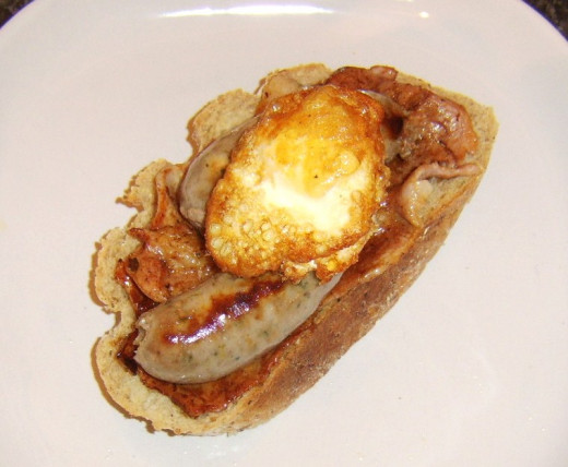 Twice cooked egg is sat on sausages and bacon