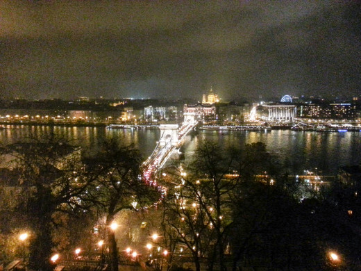 View of the Pest side from the Buda Castle, with the Chain Bridge in the foreground and St. Stephen's Basilica in the distance.