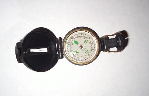A hand-held navigational compass.