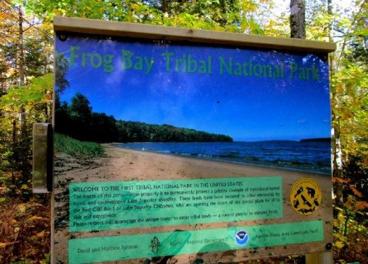 Frog Bay Tribal National Park Sign with a picture of Frog Bay Beach on Lake Superior on it.
