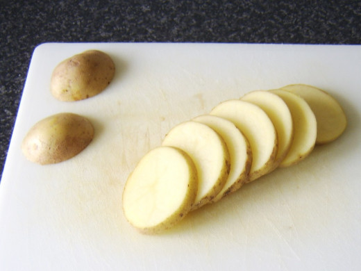 Potatoes are sliced for frying