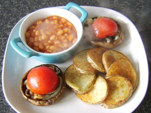 Baked beans in small dish are plated