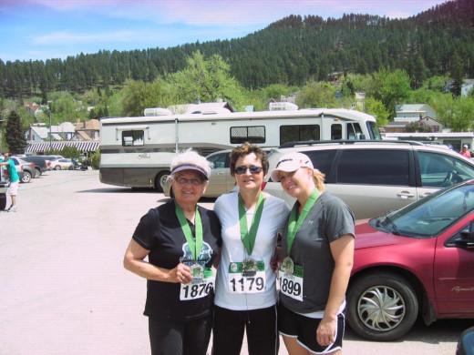 Jeanne, daughter Rene Brand, and granddaughter Kelsey Koch. Finish of Mickleson Trail Half Marathon in 2010.