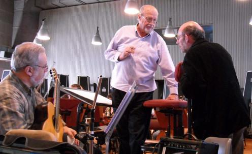 """Eduardo Isaac (guitar),  Pedro Ignacio Calderón (Conductor), and Oscar Edelstein (composer) in rehearsal for Edelstein's """"La Foto del Tiempo."""""""