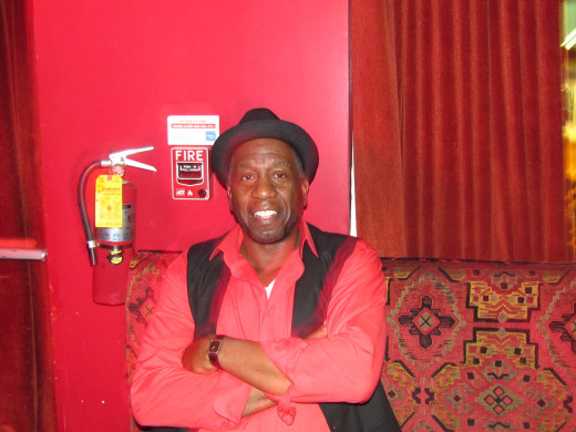 Winston Ferguson, plays bass guitar and serves as organizer of Point Blank band.