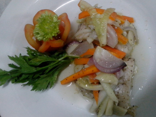 French Cuisine: Modified Fish en Papillote  (minus the parchment paper or aluminum foil)-fish fillet with julienned carrots, cucumber or zucchini and onion in salt-pepper-oil coating  (Photo Source: Ireno A. Alcala)