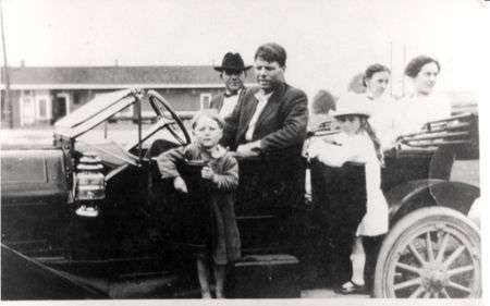 Bobby Dunbar standing in front of a car