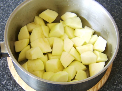 Chopped apples are added to the sugar solution