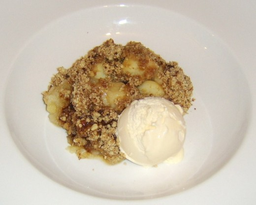 Hot crumble served with ice cream
