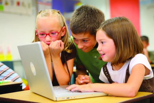 Children use computer at school.