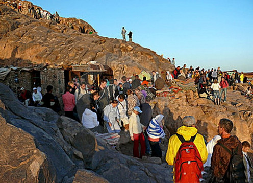 Pilgrims on descend after viewing sun rise and taking  birds eye view of Sinai mountain range from the summit. The huts seen sells tea and biscuits etc run by Bedouins.