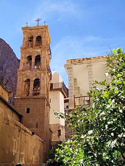 Behind the bell tower you can notice the minaret of the mosque for Muslims. The monastery is a sacred place for Muslims and Jews as well. The church wall is seen on to the left hand corner