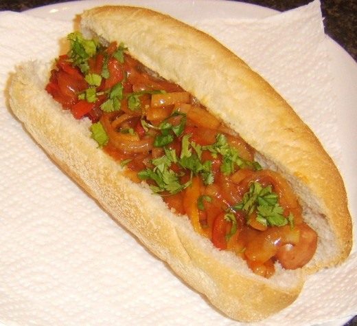 Mixed bell peppers and onion in sweet and sour sauce topped dog