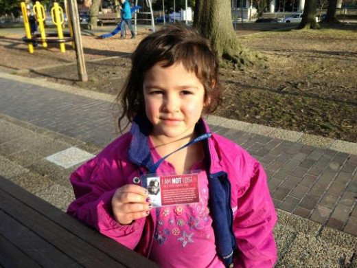 Dvora, age-6 with a tag that states that she's not lost, but a free-range child.