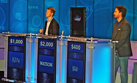 Watson the computer, pictured here in the middle of his fellow human competitors, won the American game show Jeopardy