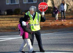 Making sure that school children get back and forth over the highway is an important duty for the crossing guard.