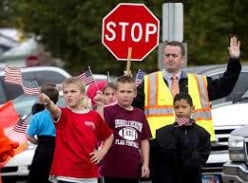 Men and women both work as crossing guards.