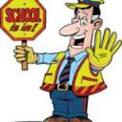 This crossing guard is very happy with his job.